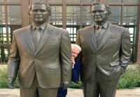 Clinton hiding behind the bushes