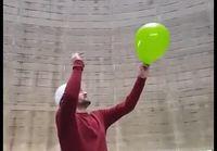 Ilmapallon poksauttaminen jäähdytystornissa